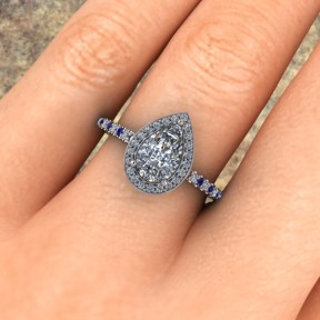 14kt white gold pear shape diamond and sapphire engagement ring
